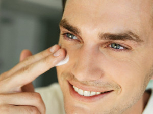 Man applying moisturizer