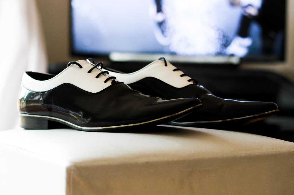 Two toned patent leather lace ups waiting to be worn