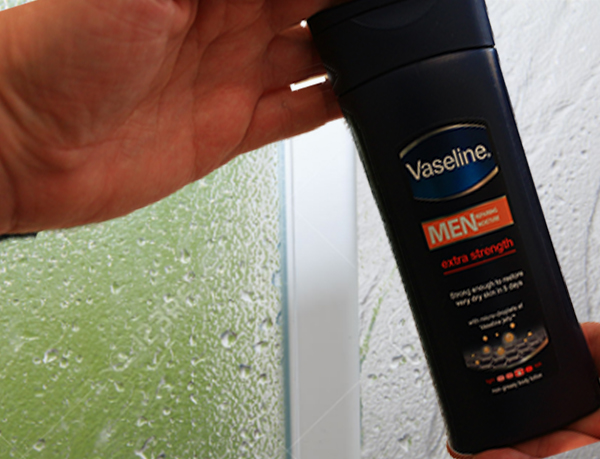 Vaseline Men Body Lotion in the shower on My Lime Boots