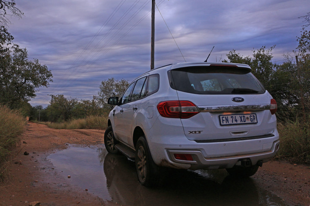 Ford Everest in a mud puddle on My Lime Boots