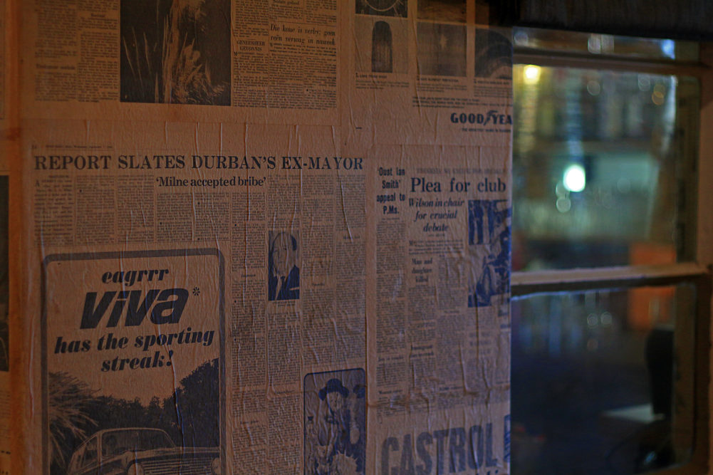 Newspapers on the wall at Sleepers Railway Station Restaurant in Hoedspruit for My Saturday Find on My Lime Boots